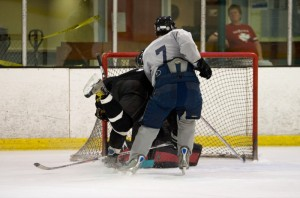Bret Sewell knocked off his skate by Frank Savino